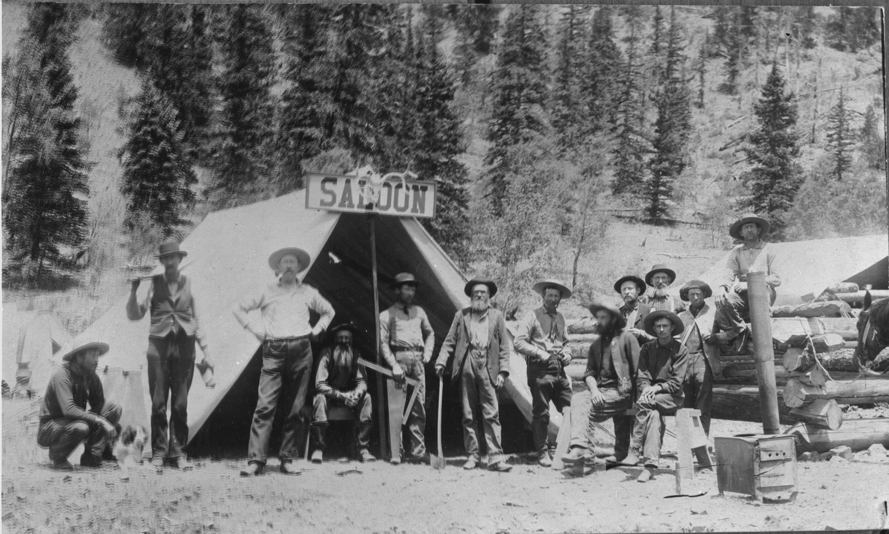 Historic photo of saloon in tent with miners