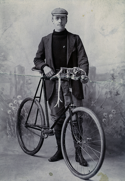A studio portrait of Fred Payne Clatworthy with a bicycle, 1897. A studio portrait of Fred Payne Clatworthy with a bicycle, 1897.
