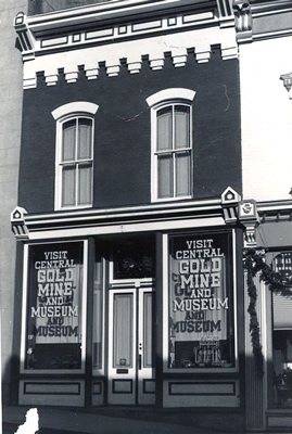 Black and white photo of a nineteenth century commercial structure.