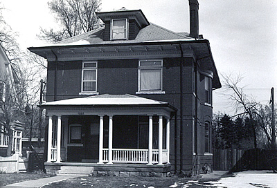 Black and white photo of a Foursquare style house.