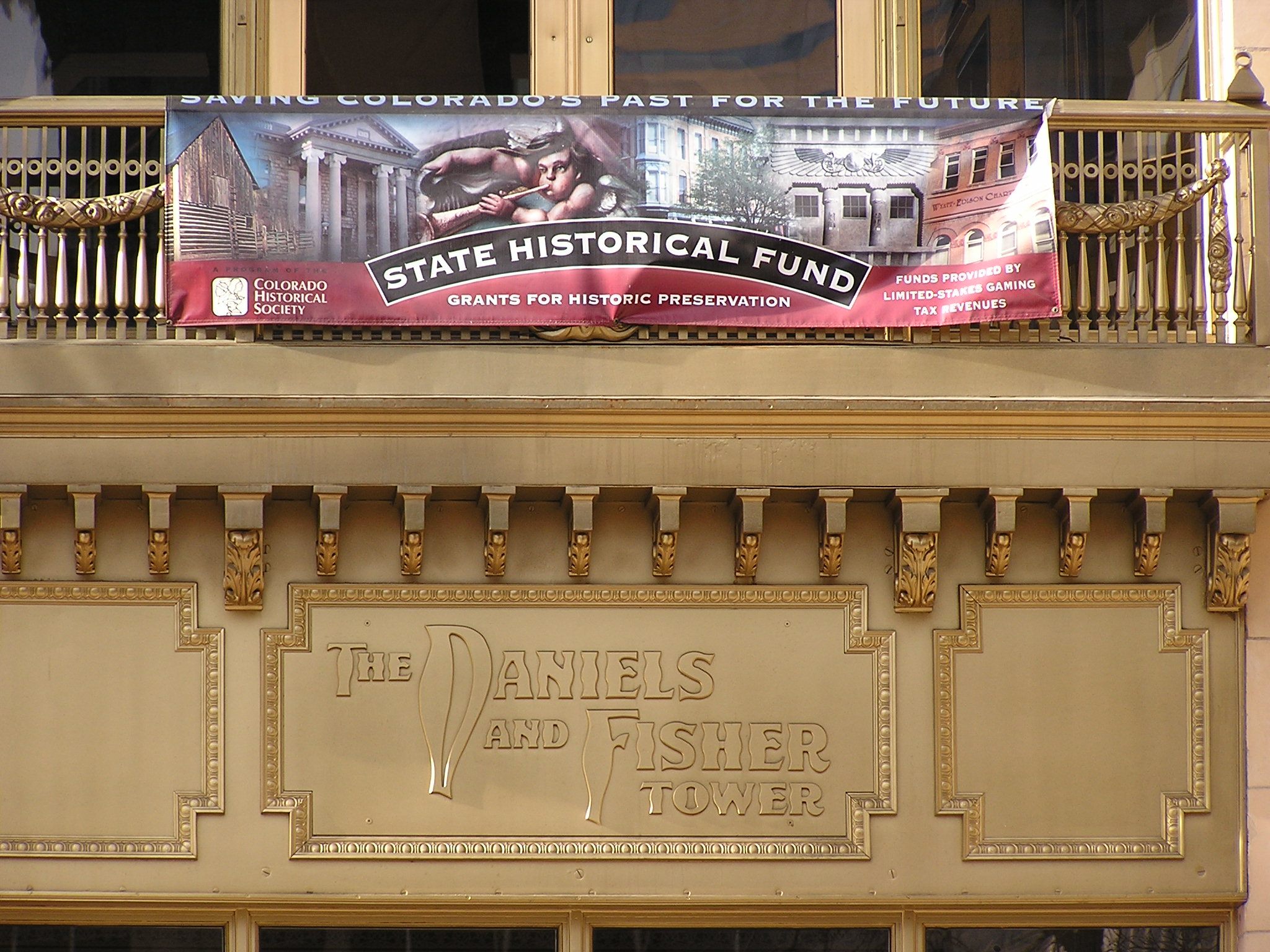 A State Historical Fund banner over the entrance to the Daniels & Fisher Tower.