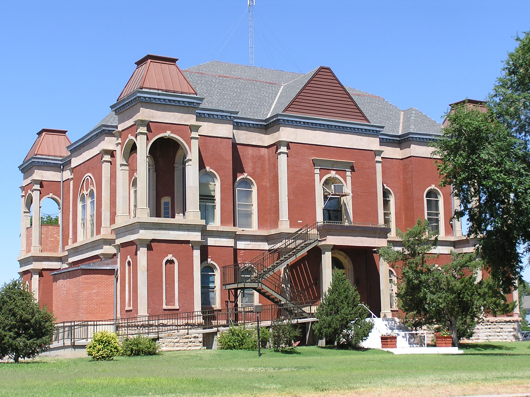 A photo of the Bent County Courthouse and Jail in Las Animas, a two story red brick building.