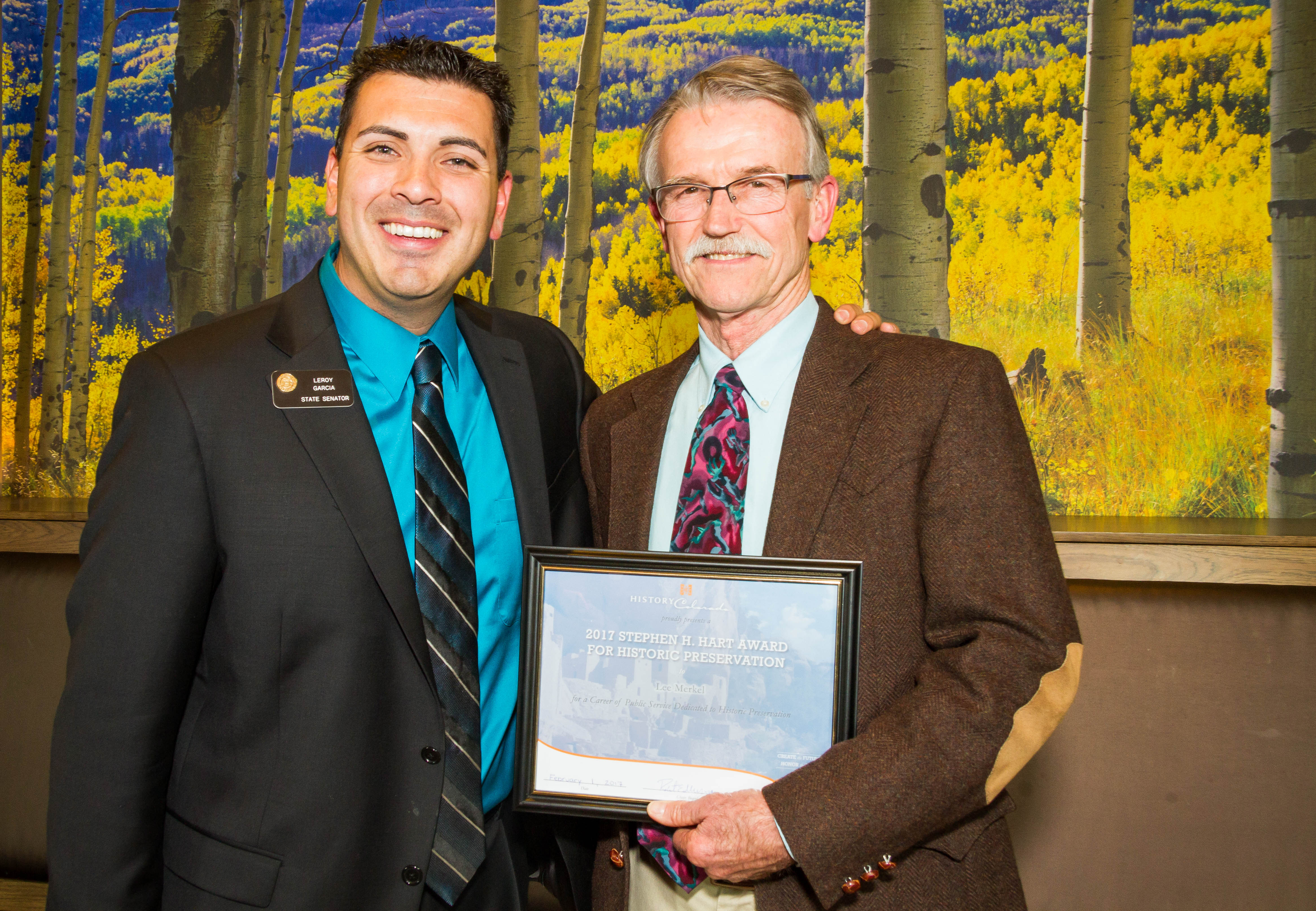 State Senator Leroy Garcia stands next to Lee Merkel, who is holding his recently received Hart Award certificate.