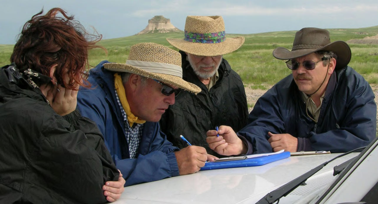 Three survey volunteers with former assistant State Archaeologist Keving Black (right) on the 2014 PAAC Summer Survey in the Pawnee National Grasslands