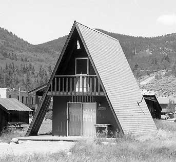 Black and white photo of an A-Frame house.