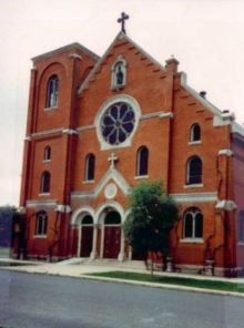 The red-brick Annunciation Church in Denver, which is built in the Gothic and Romanesque Revival styles.