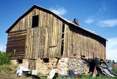 Color image of a bank barn.
