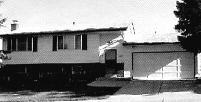 Black and white photo of a bi-level house in Castle Rock