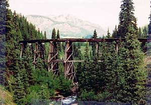 Color photo of a timber Stringer bridge.