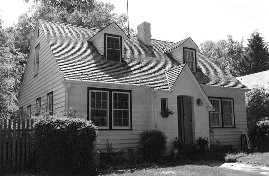 black and white photo of a Cape Cod style home in Greeley.