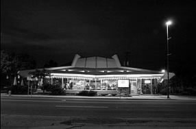 Black and white photo of a Googie style building.