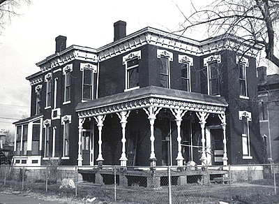 Black and white photo of an Italianate style structure.