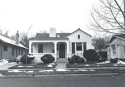Black and white photo of a Mediterranean Revival style house.