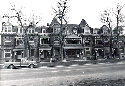 Black and white photograph of Queen Anne style row