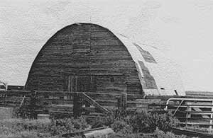 Black and white photo of a Round-Roof Barn.