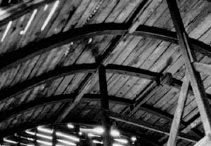 Black and white photo of the interior rafters in a Round-Roof Barn.