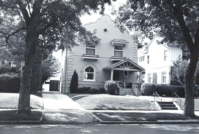 Black and white photograph of a Spanish Colonial Revival style house.