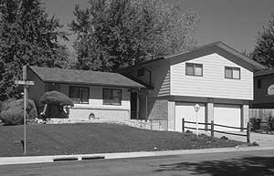 Black and white photo of a split-level home