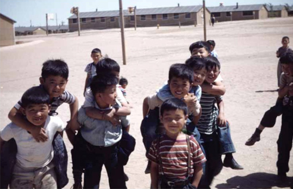 Children at Amache playing piggy-back races