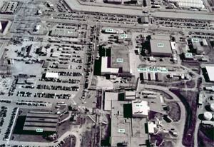 A black and white photo with blue labels of an overhead shot of the facilities.