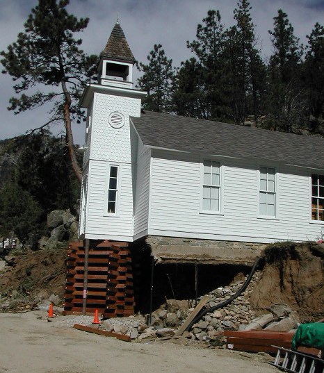 The Little Church in the Pines supported by an emergency structure after a flood.