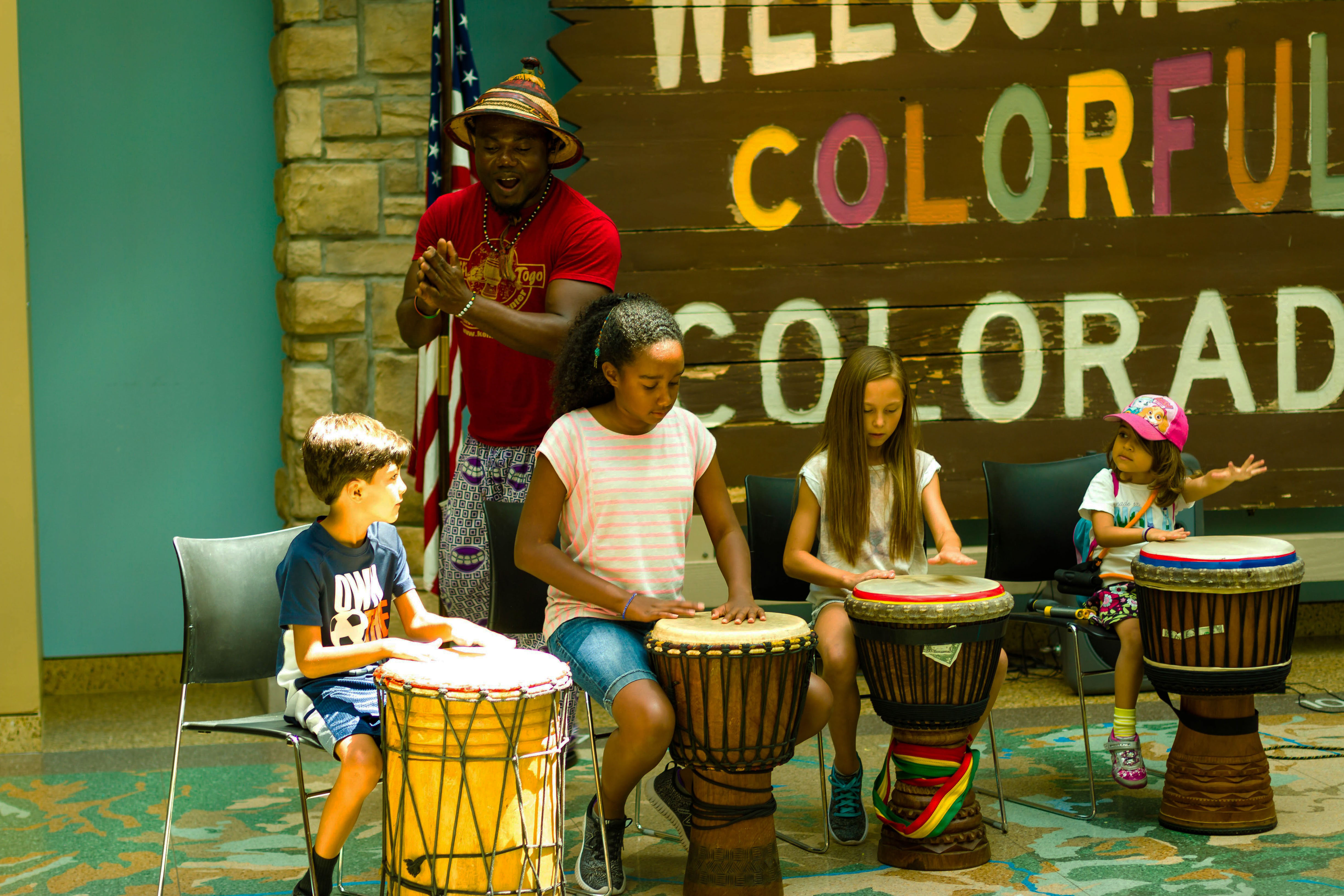 children playing African drums