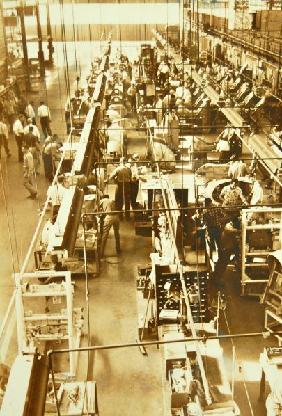 Historic photo showing workers at the Stanley Aviation complex.