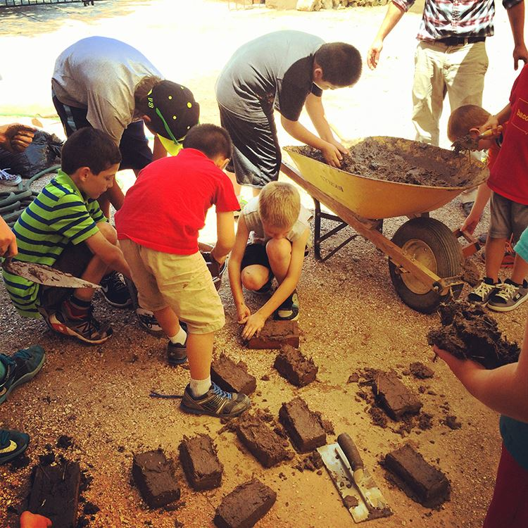 Students participating in a hands-on adobe making activity at El Pueblo History Museum.