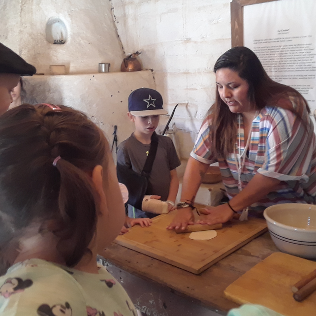 Students learn about tortilla making at El Pueblo History Museum.