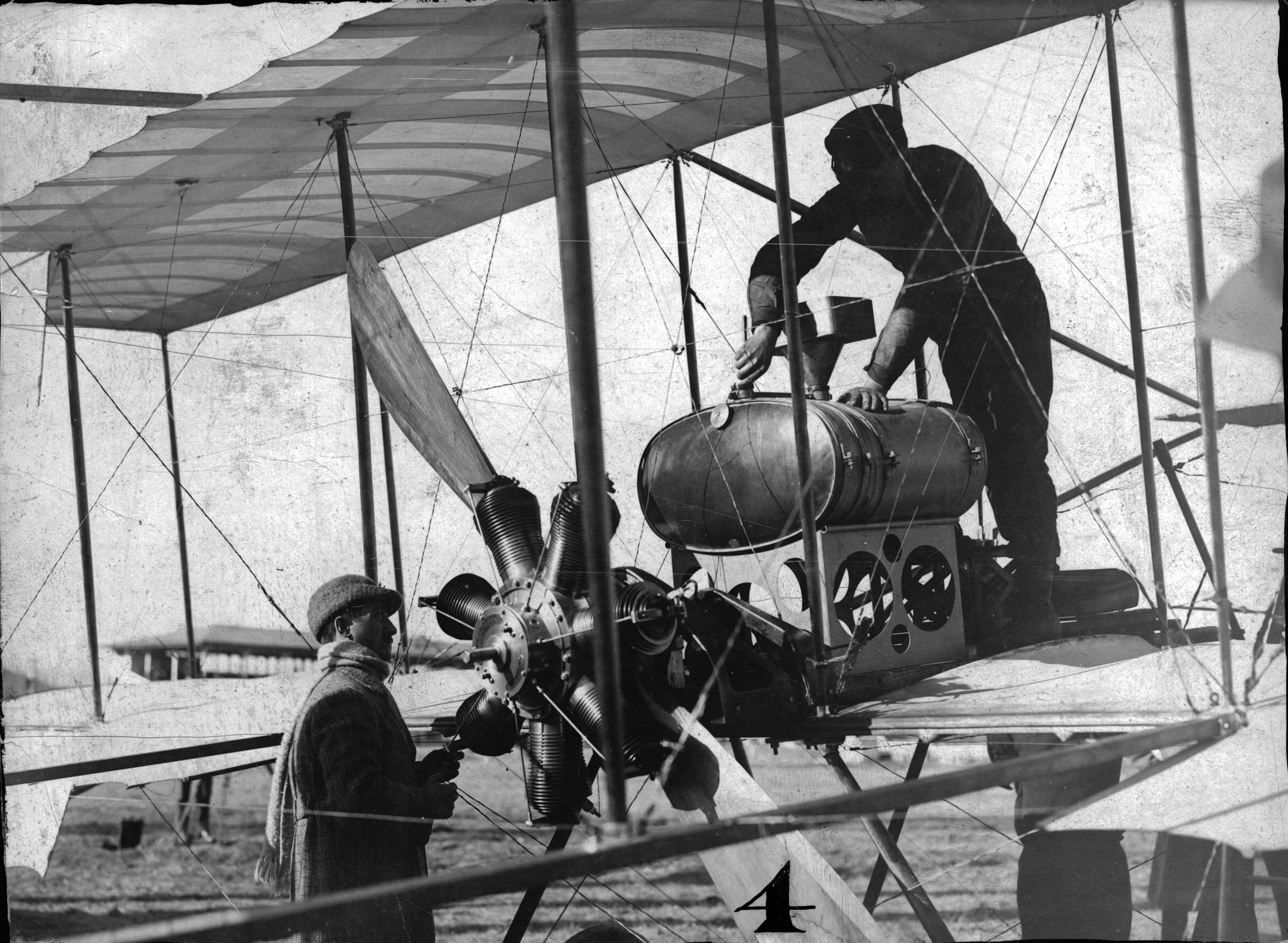 Louis Paulhan and his airplane in 1910