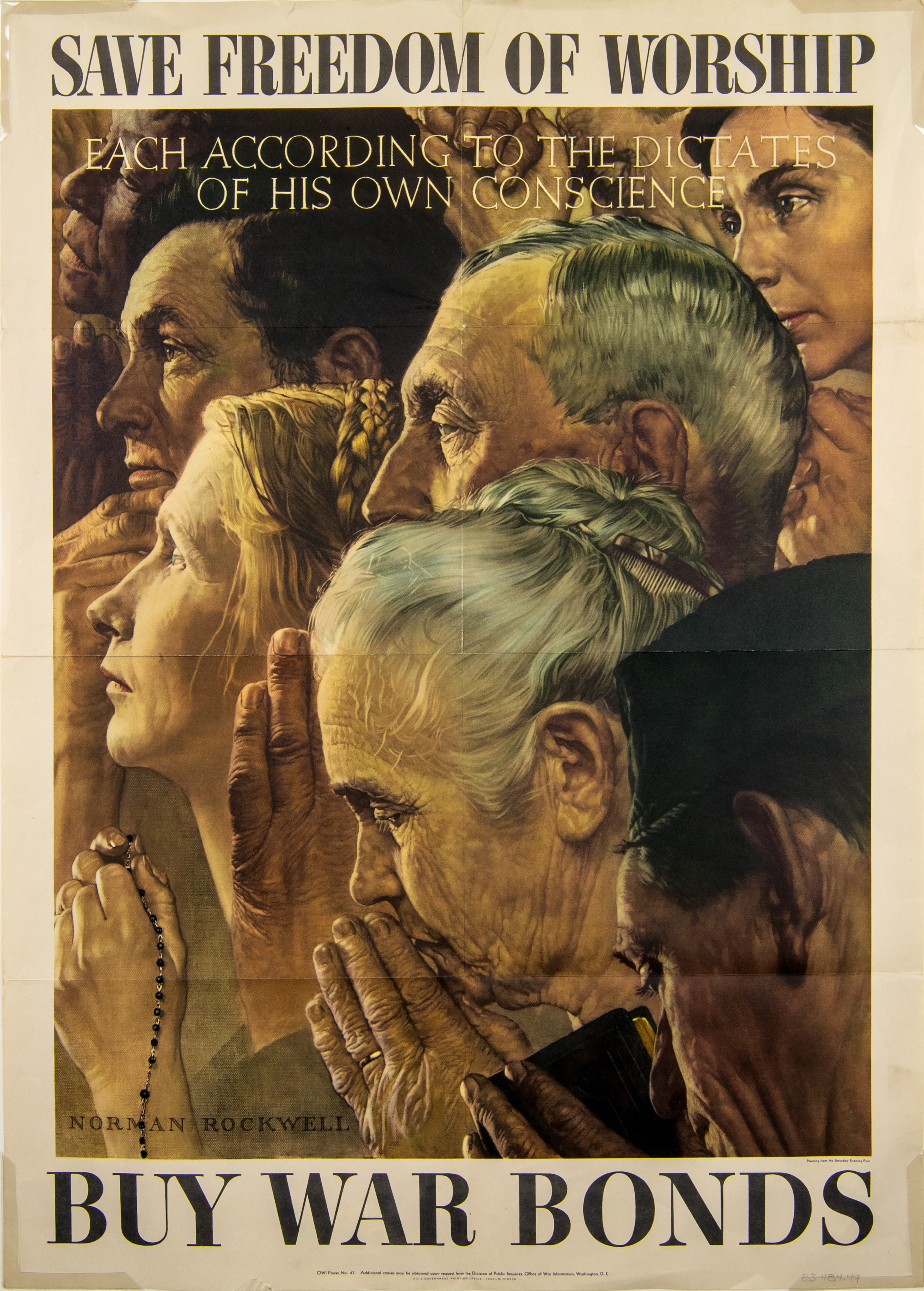 Photo of a poster from 1943, used to sell war bonds. Norman Rockwell's image of faces of Americans shown in a group, gathered together to pray and worship in different ways. One woman holds a rosary, another man holds a religious book.