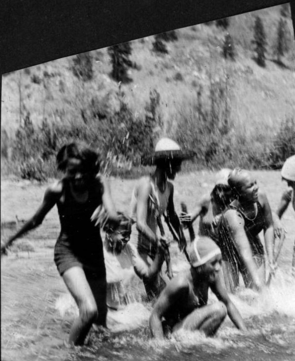 Young women splashing in river at Camp Nizhoni, 1929 or 1930