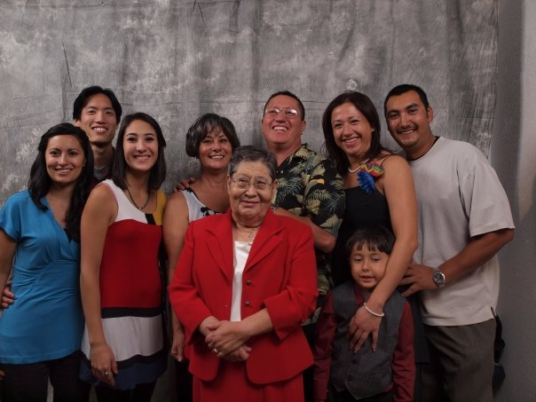 Shanea (third from left) with her extended family, including her grandmother Priscilla in the center.