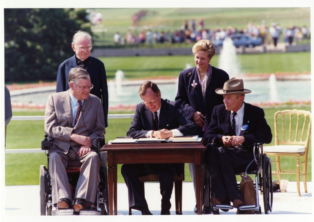 George H W Bush signs American Disability Act