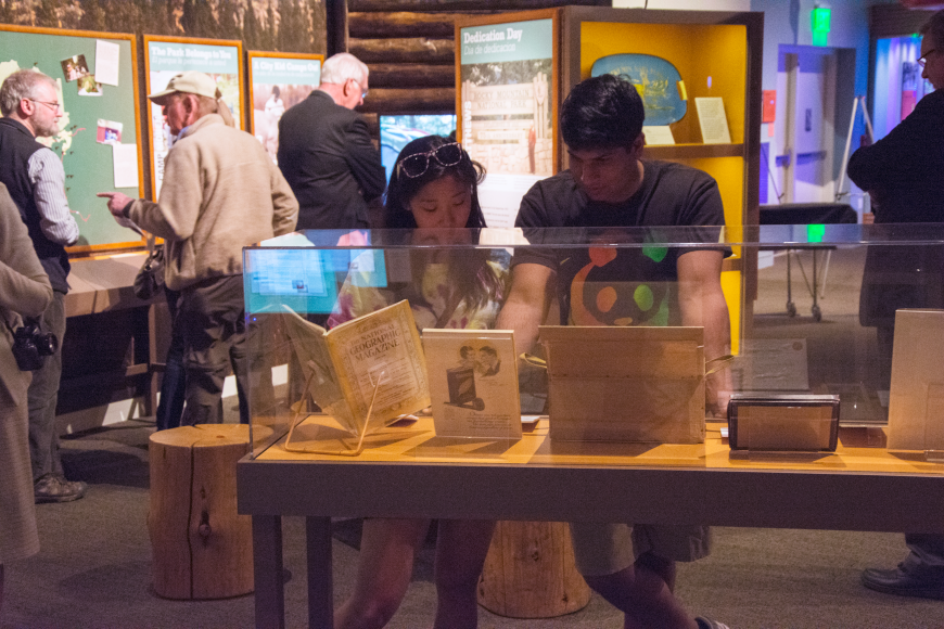 A pair of visitors examine a RMNP100 displace case.