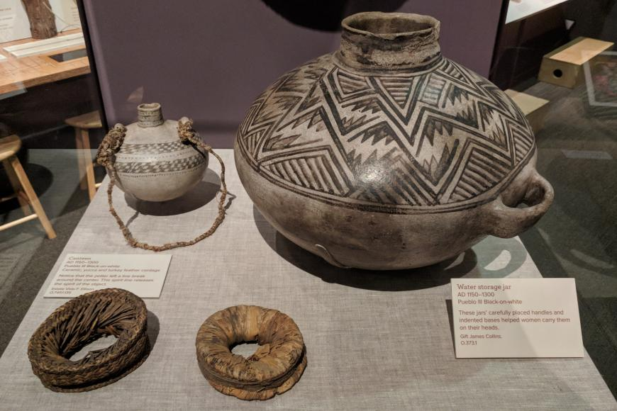 Display showing a canteen and water jug from AD 1150-1300
