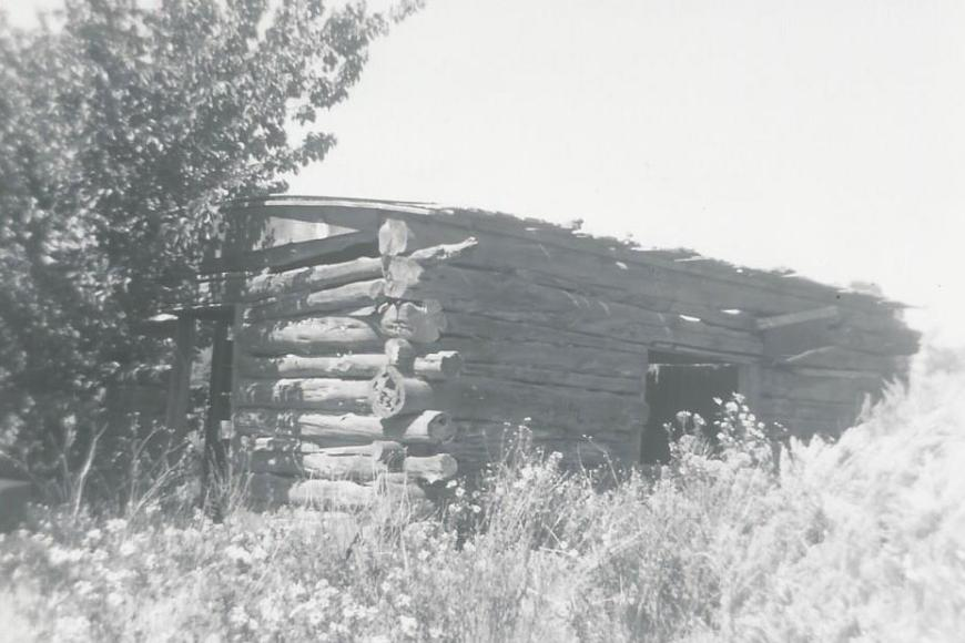 Historic photo showing the original log cabin on the Allen Family Homestead.
