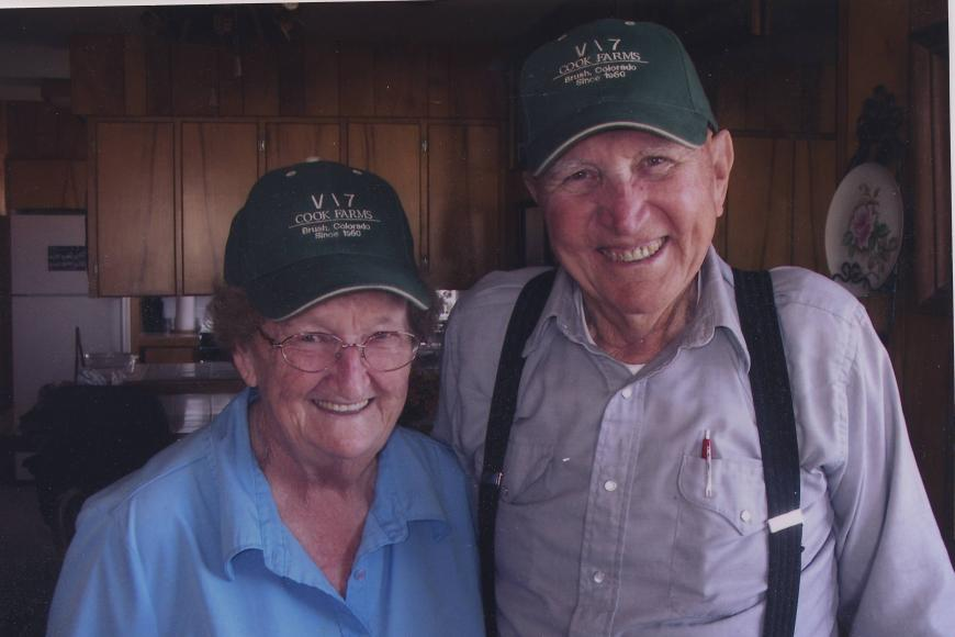 Members of the Crook Ranch proudly show off hats with the ranch brand.