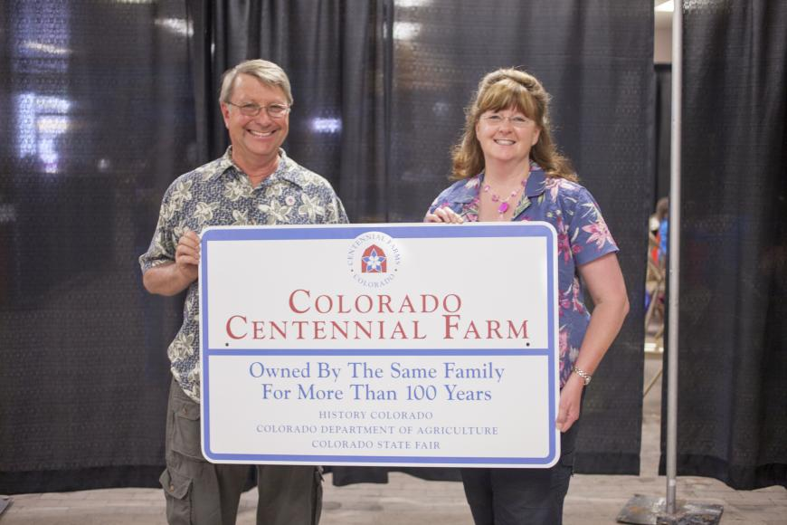 Members of the Westesen Farm & Ranch with their Centennial Farm and Ranch sign.