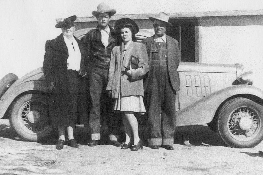 Members ofThe Bailey family standing in front of a car on the ranch, 1943.