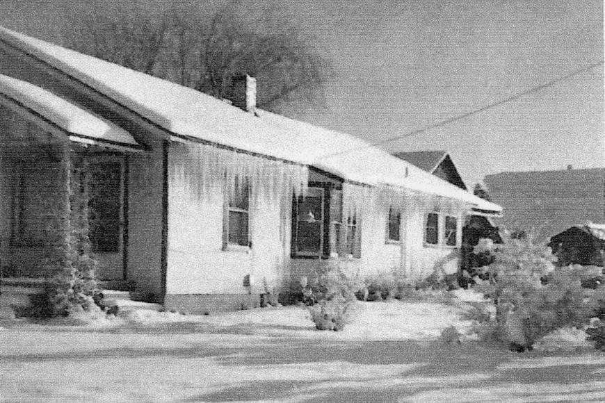 A 1948 photo on a snowy day shows the house that Clarence and Lucile Everett built after the 1942 fire.