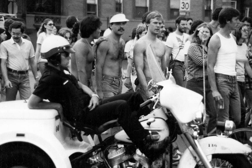 Gay and Lesbian Community Center of Colorado Collection photo of policeman and parade attendees at Gay Pride March in 1981