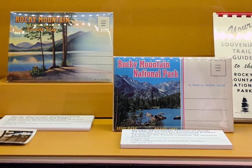 Display case full of Rocky Mountain National Park postcards.