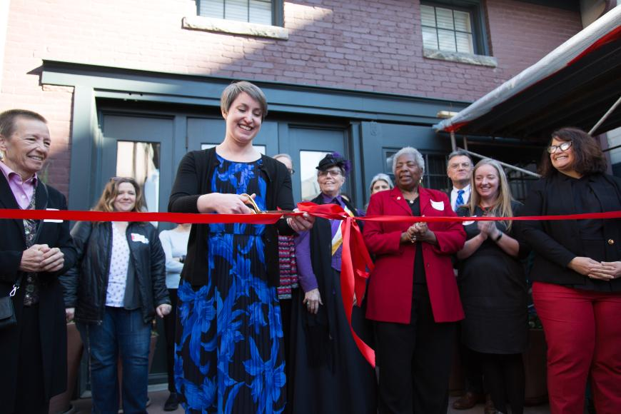 Jillian Allison cutting ribbon at Byers Evans