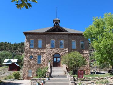 A photo of the Animas City School building