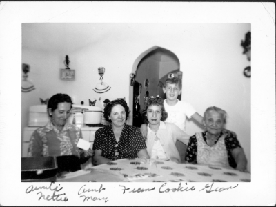 Photograph of Aunt Nettie, Aunt Mary, Frances, Cookie, and Gram Sitting Around Kitchen Table.