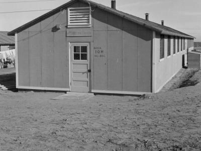 Photo from Amache internment camp in 1943 - a wooden framed, one-story building named Block 10-H