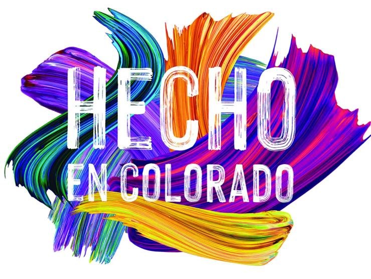 Image of the Hecho en Colorado exhibition logo. The title of the exhibition is in white lettering which looks painted with a brush, and behind the text are what look like paint brush strokes in bright blues, pinks and purples, and yellows.