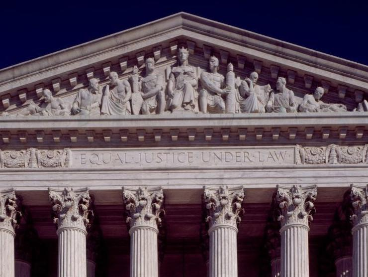 "Detail of West Pediment of Supreme Court Building. The nine figures featured are Liberty Enthroned in the center, with Order on her right and Authority on her left. Council, with Research (past and present) are also visible, as are the words. ""Equal Justice Under Law."""