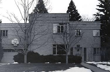 Black and white photograph depicting a Moderne style house